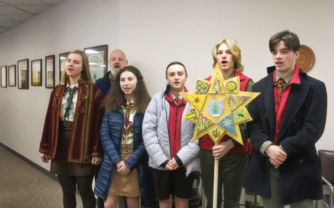 Young carolers visit UNA Home Office